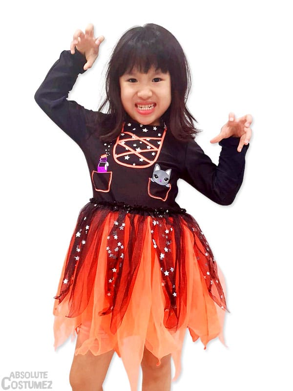 Kitty Orange Witch is a creepy but colourful costume for children